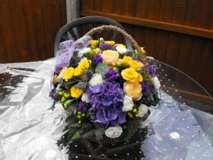 purple and yellow bouquet in a basket